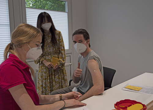 Company doctors vaccinate employees and family members